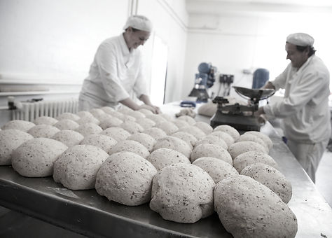 Craft bakers handmaking bread