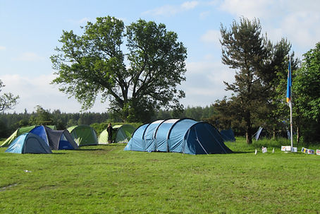 Photo of campsite with several tents