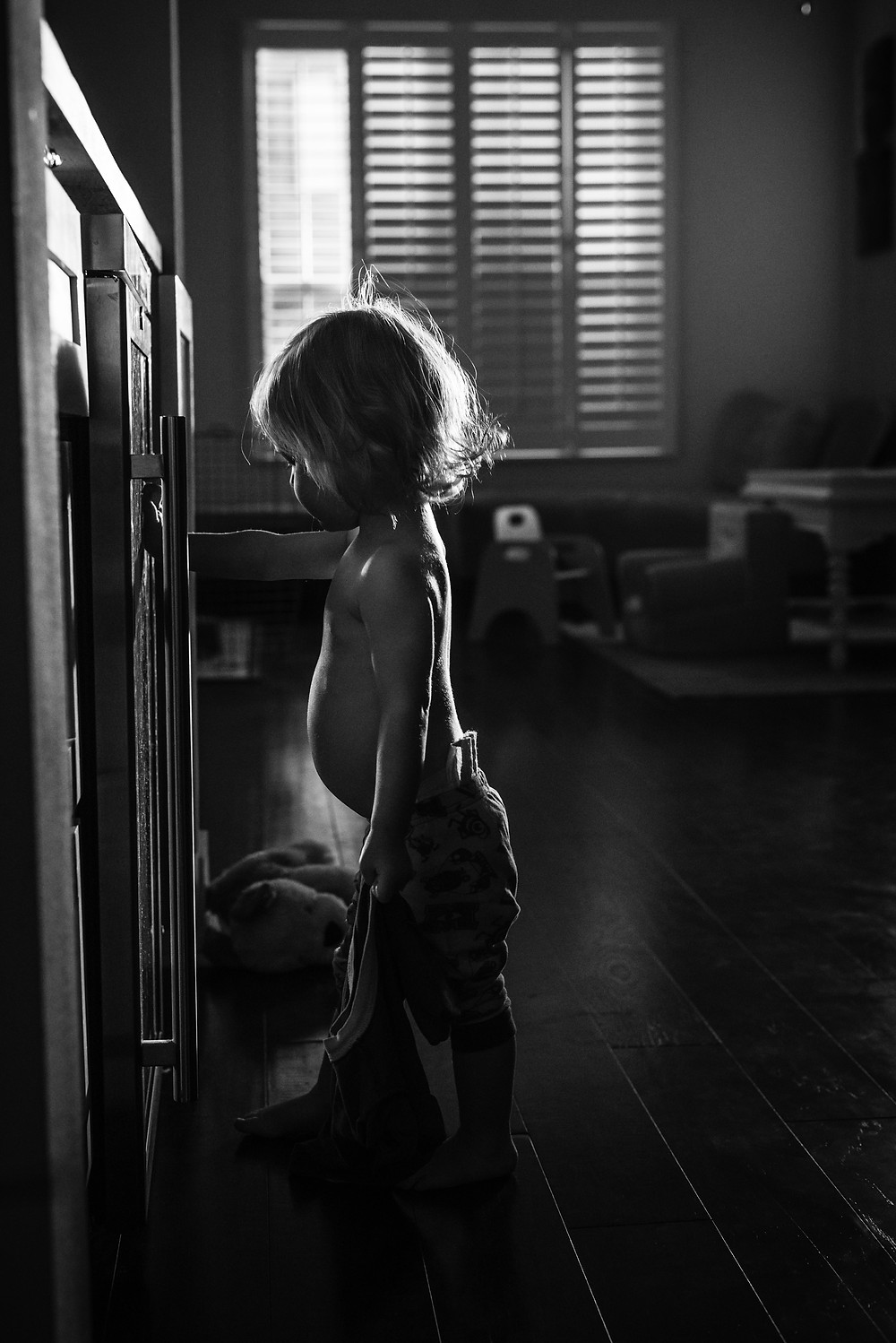 A child after my own heart during an in home lifestyle photo session in Austin TX