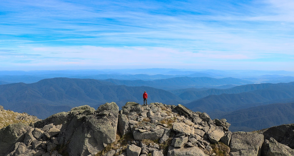Man climbing Mount Kosciuszko