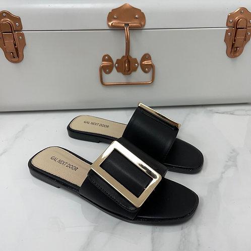 Meera - Black Square Toe Gold Rectangle Detail Slip On Flat Sandal