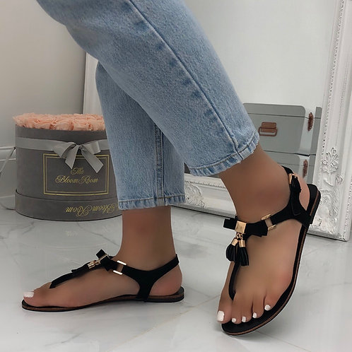 May - Black with Gold Bow and Tassel Buckle Up Flat Toe Post Sandal
