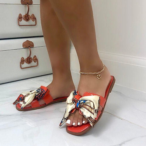 Polly - Orange Patent Chain Print Silk Scarf Bow Slip On Sandals