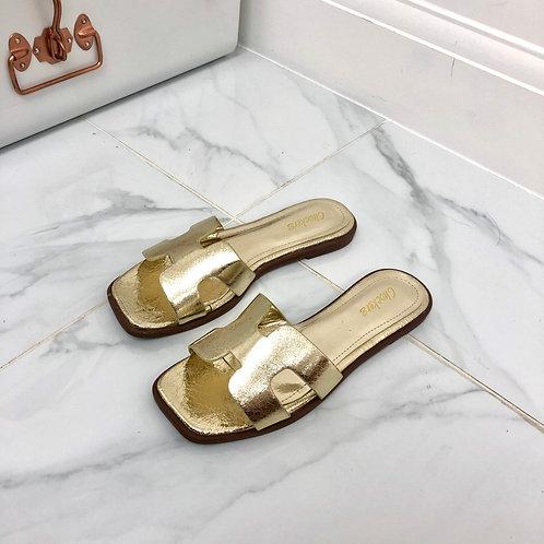 Harriet - Metallic Gold H Style Square Toe Slip On Flat Sandals