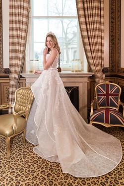 A happy Audrey Ametis Weddings Bride