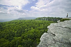 Photo of person on cliff at Mohonk Preserve