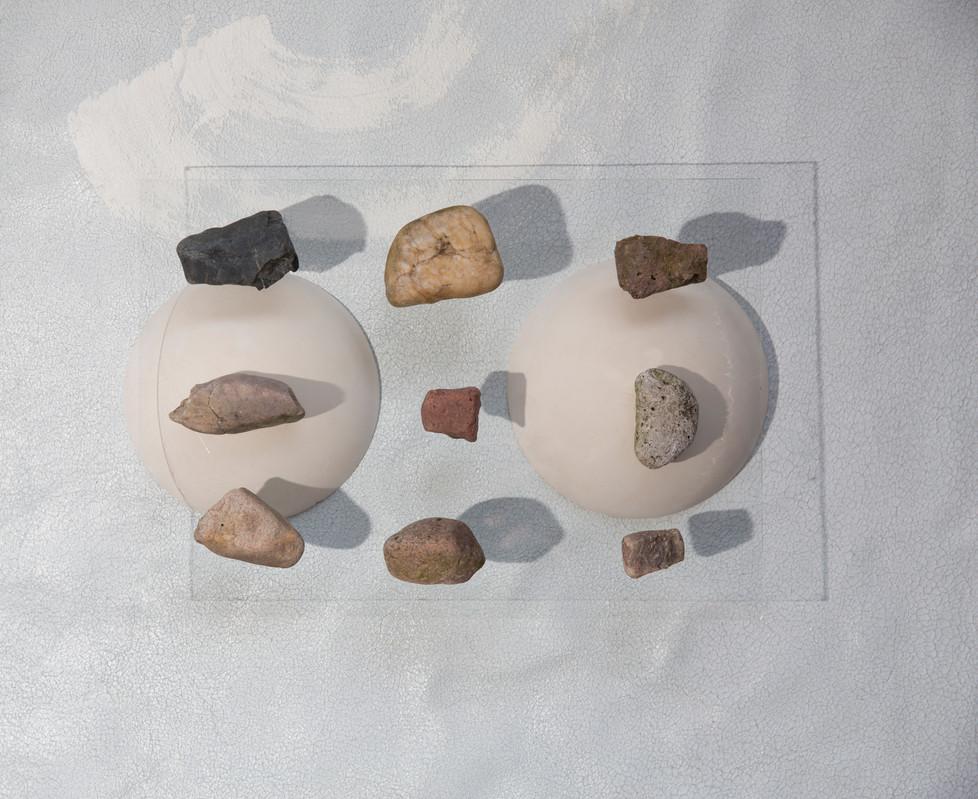 Phisical, Mental, Spiritual | 2017 | Plaster, rocks, light and glass |  30 x 21 x 0,5 cm