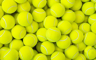 Lots of vibrant tennis balls, pattern of