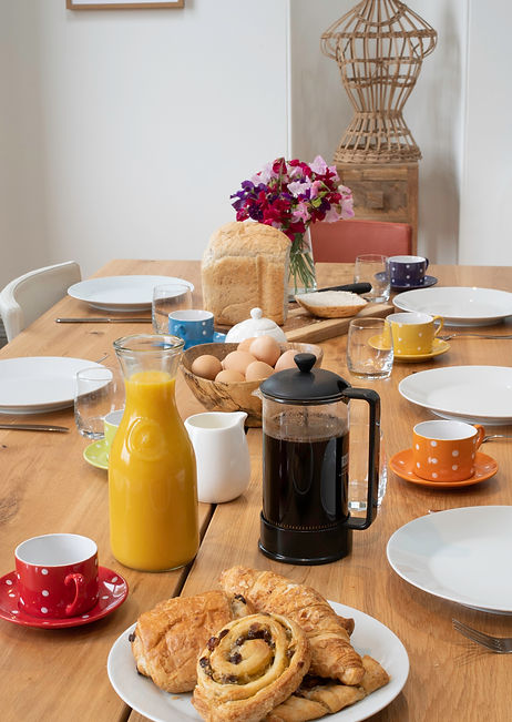 Breakfast at The Five Turrets - croissants and orange juice on the dining table