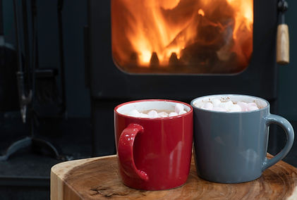 Hot chocolate and a roaring fire: the cosy fireside at The Five Turrets, luxury self catering accommodation in the Scottish Borders.