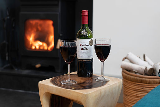 A roaring fire, a glass of wine: make yourself at home in The Five Turrets, the historic holiday home at the heart of the Scottish Borders