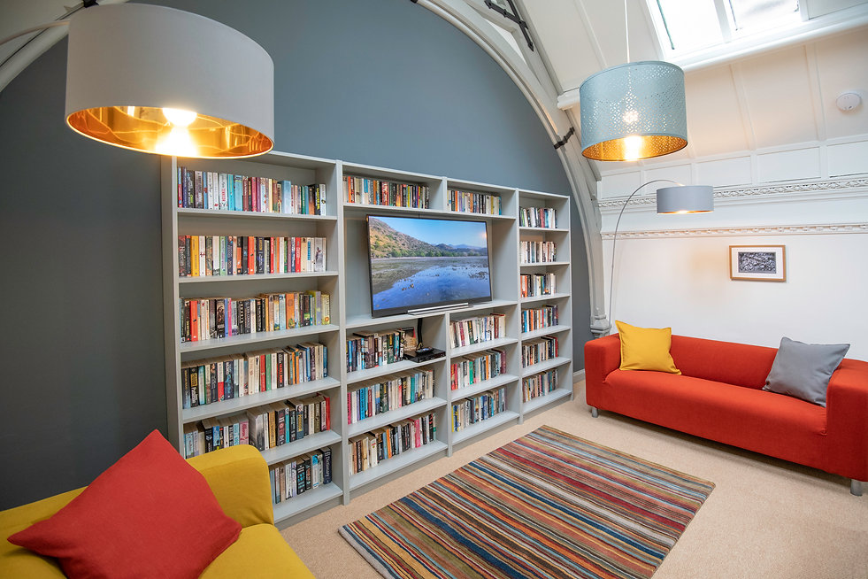The 600-book library and TV viewing balcony room on the mezzanine of The Five Turrets, the historic holiday home at the heart of the Scottish Borders