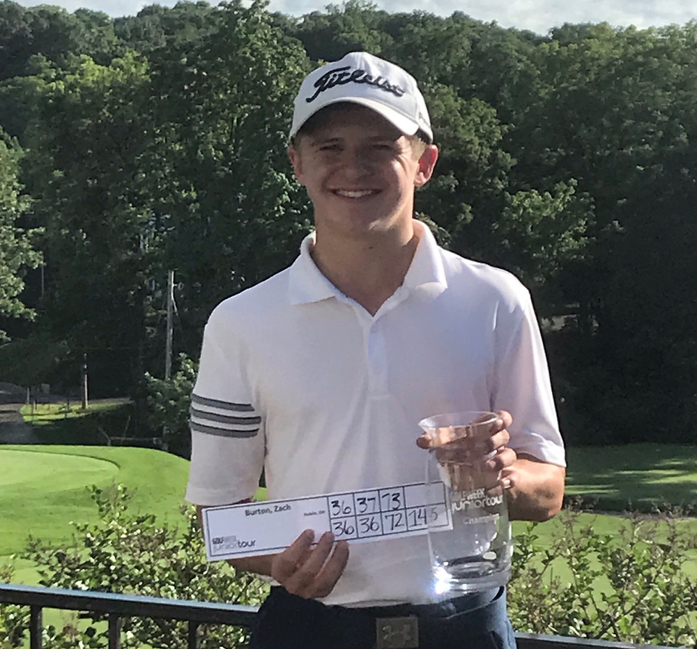 Zach Burton poses with his score and trophy.
