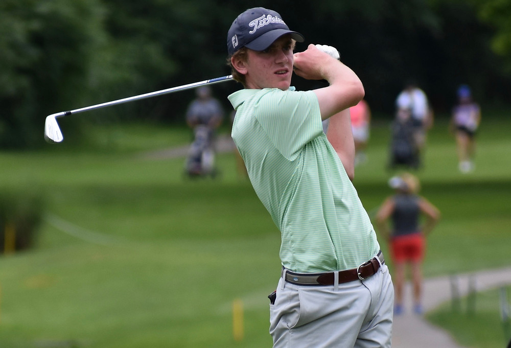 Henry Perry hits an approach shot during his victory at Dayton Country Club.