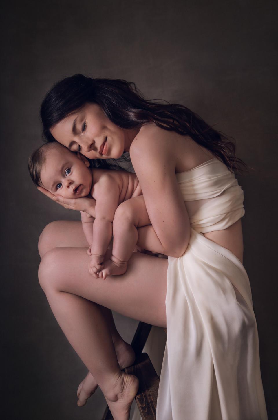mother holding child asleep baby photogr