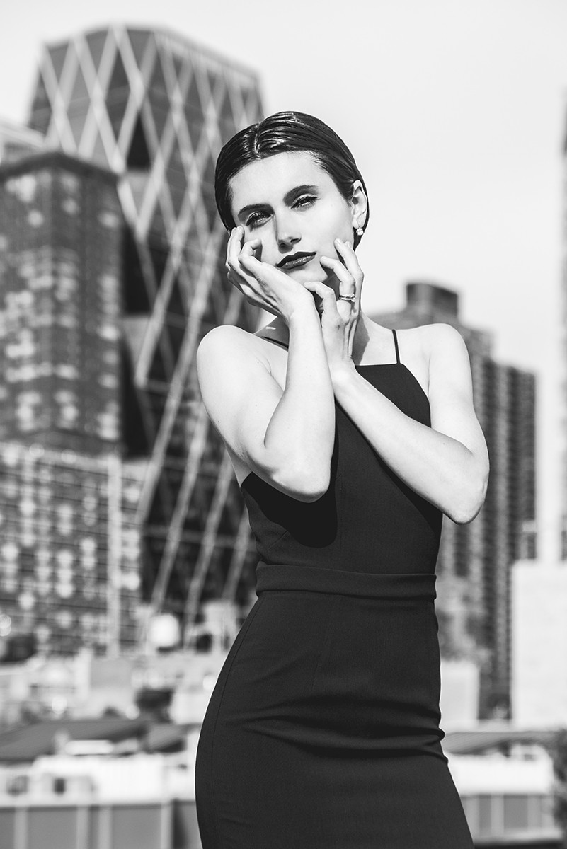 elegant woman on rooftop black and white
