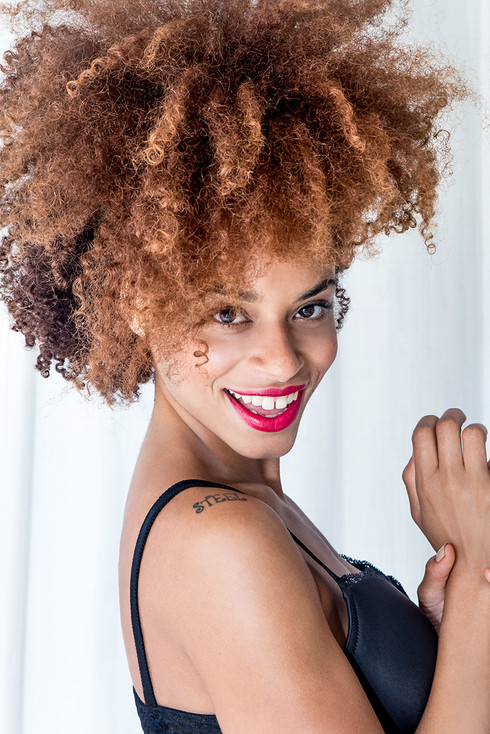 gorgeous black woman red lipstick smilin