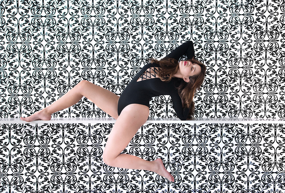dancer posing in front of graphic wall b