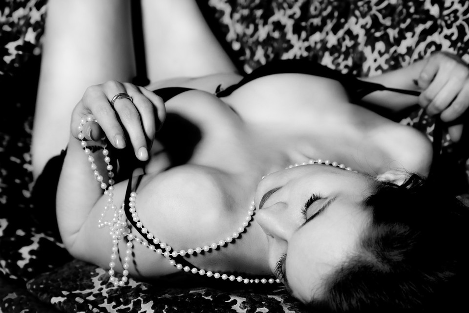 anonymous woman lying down with pearls by fleur losfeld