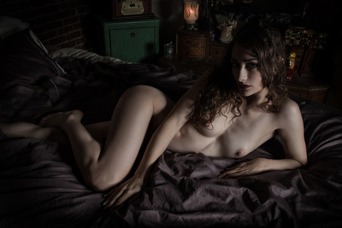 painterly portrait of nude woman lying o
