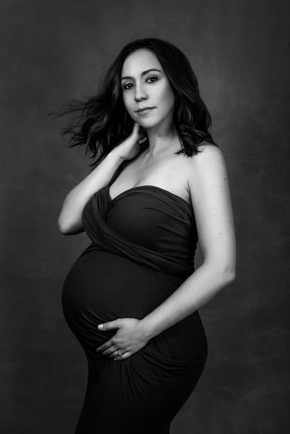 dramatic maternity portrait hair in the