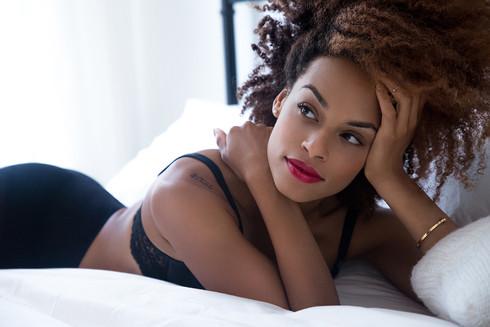 gorgeous black woman lying natural hair by fleur losfeld