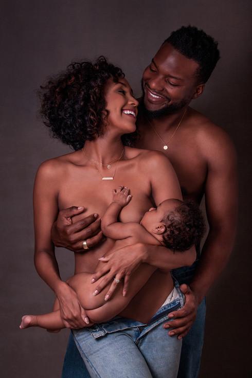 happy black family smiling breastfeeding
