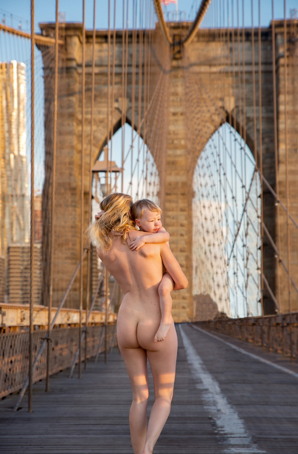 woman holding toddler brooklyn bridge ny