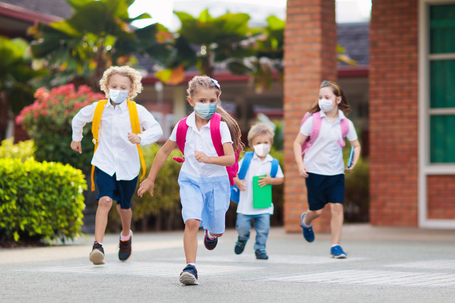 School child wearing face mask during co