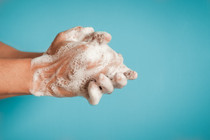 Closeup of person washing hands isolated