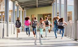 Elementary school kids running at school