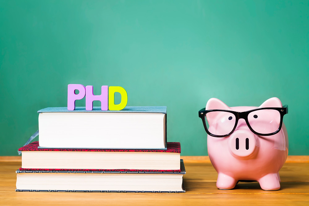 PhD degree theme with textbooks and piggy bank with glasses