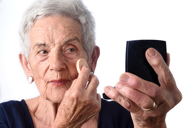 Senior woman make-up face on white background