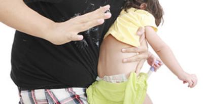 Man spanking small child