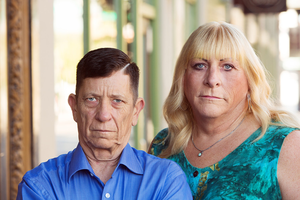 Serious transgender couple standing together
