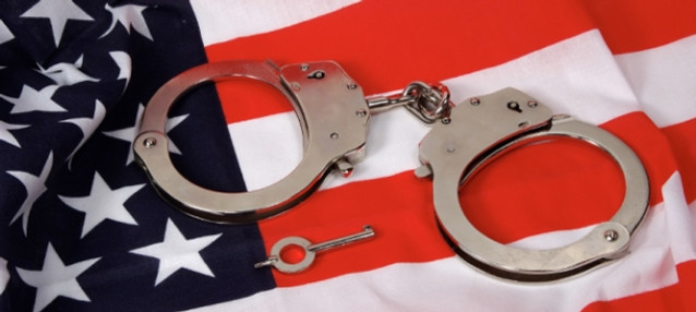Handcuffs on top of the American flag