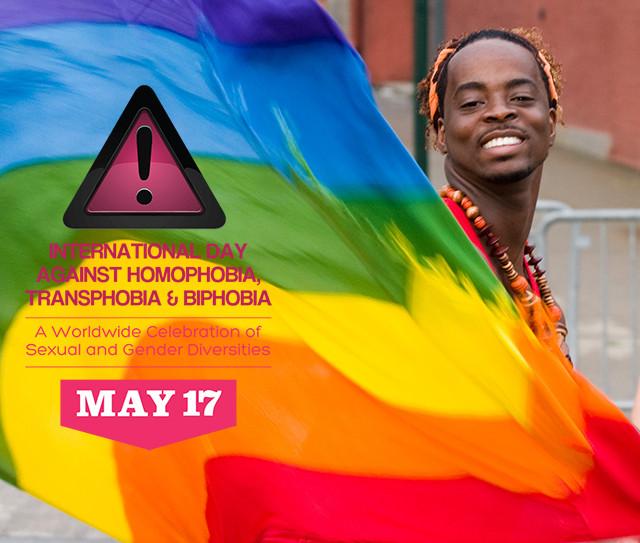 IDAHOT logo over man with rainbow flag