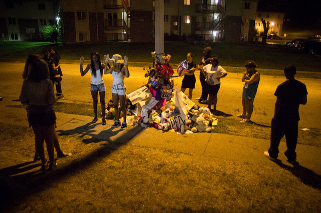 Young people gather around the Michael Brown memorial in Ferguson, MO