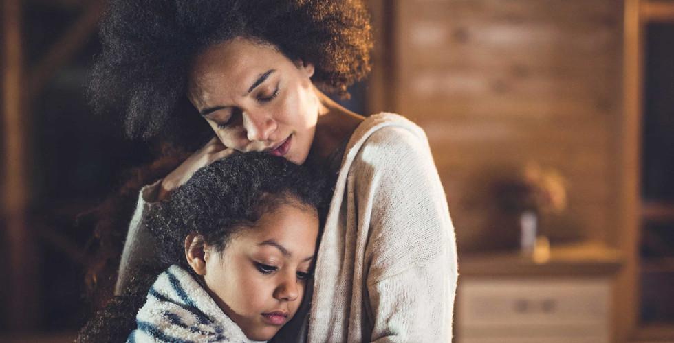Black-Mother-Hugging-Child_edited.jpg