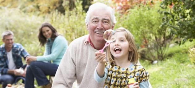 Grandfather and granddaughter at picnic
