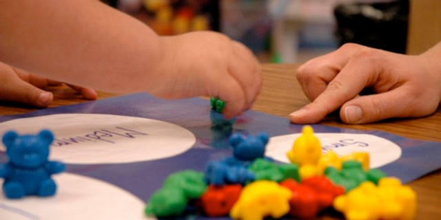 Child working on a project at preschool