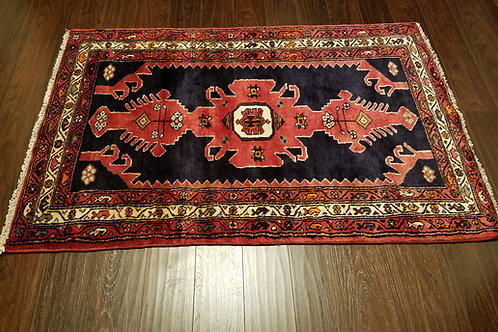 Side view of Kharaghan Persian rug