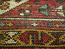 Back of Gharajeh rug showing weft color and material.