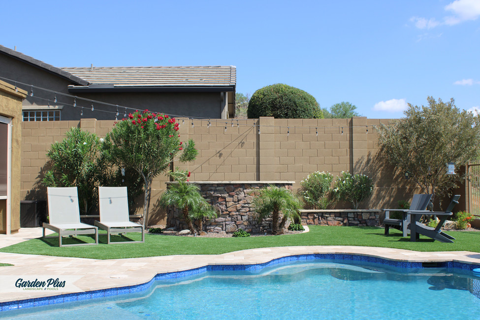 Backyard Artificial Turf and Travertine Pavers