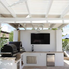 White tv wall, outdoor kitchen, backyard lattice pergola