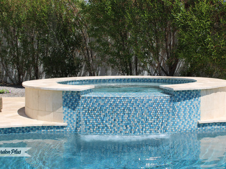 Spillway spa with travertine seating border