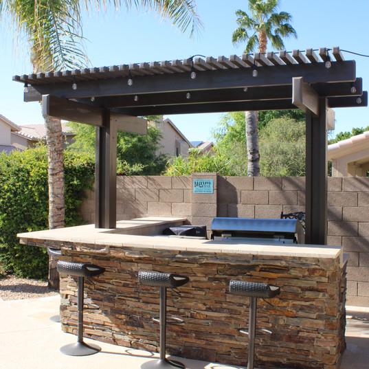 Outdoor kitchen w/ pergola