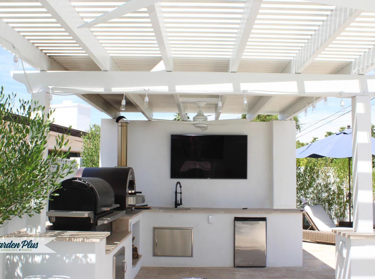 Outdoor Kitchen feat. Pizza Oven, TV Wall, BBQ, Mini Fridge.