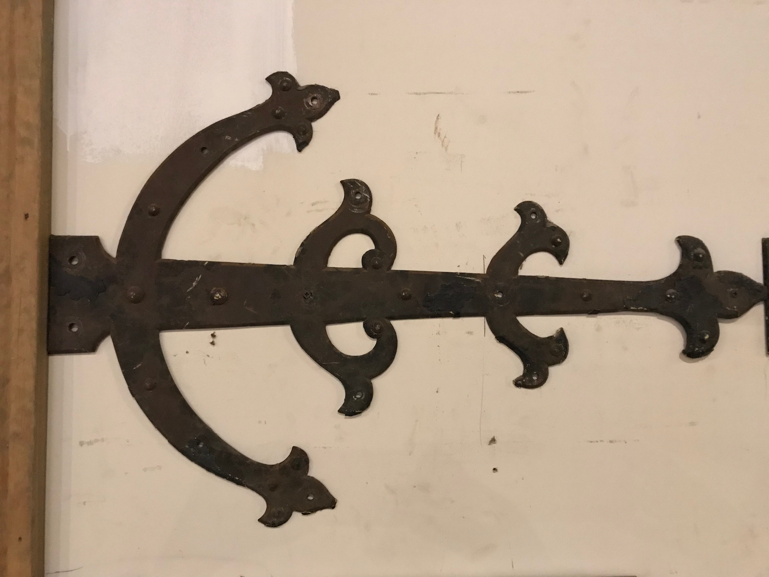 Large bronze hinge from church door.