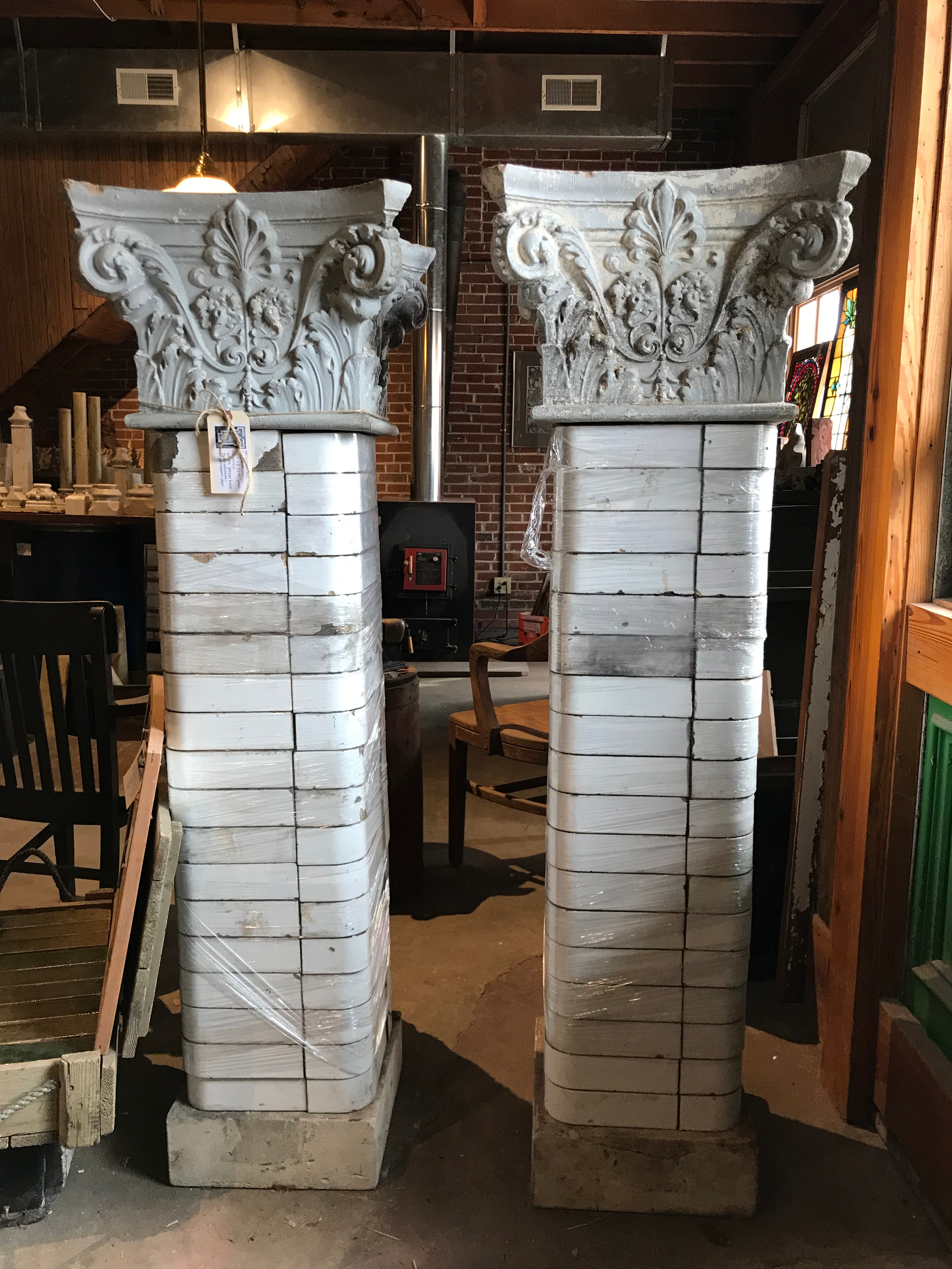 White glazed brick porch columns with Corinthian caps.